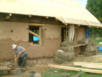 natural plaster mixed with a shovel and applied onto the straw bale walls