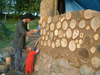 volunteers on a cordwood workshop