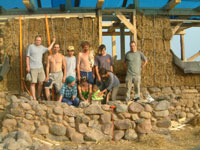 volunteers who completed the first wall of a straw bale wall system with hazel pinning and natural stone foundations