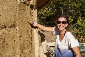The walls take shape... clay plastering the bale walls.