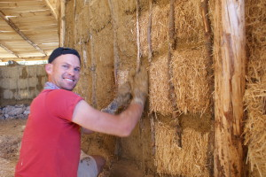 Clay plastering the joints between bales...