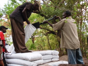 Local men filling earthbags at our project in Zambia