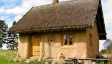 Paulina's first straw bale house, built in 2000 by the shore of Lake Hancza, Eastern Poland.