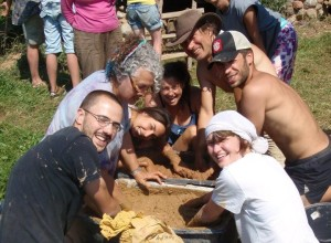 People having fun at a Clay Plastering Workshop run by Earth, Hands and Houses.
